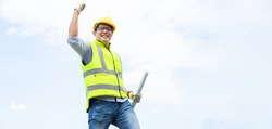 Success Asian man construction worker in hardhat. Celebration victory Success winning Leadership Concept