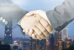 Success business concept,Double exposure of handshake and city,businesspeople workingTogether,businessman and businesswoman shaking hands,selective focus,vintage color