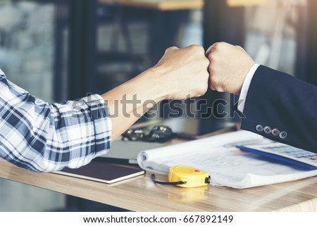 Success Business Partners Giving Fist Bump after Complete a Deal. Successful Teamwork with Hands Gesture Communication. Businessman with Team Agreement in Corporate. Partnership Business Concept