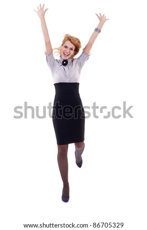 Success business woman jumping happy ecstatic celebrating with arms in the air.