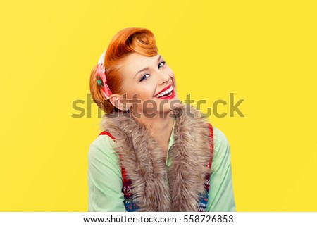 Success. Closeup portrait beautiful radiant businesswoman looking at you camera isolated yellow background wall.  Pinup girl retro vintage clothing 50's  hairstyle smiling Positive human emotions life