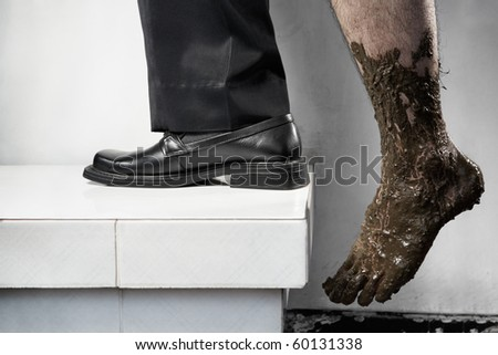 Success concept from poor to be rich, one leg step from below with full of mud and the other leg using business attire. Legs of one person, without composit
