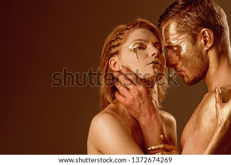 success concept. success and luxury concept with sexy couple painted in gold color, copy space