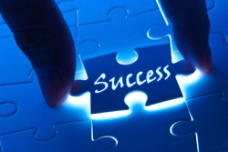 Success concept, Success word on puzzle piece with back light