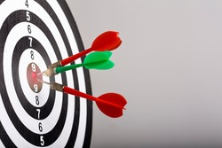 Success hitting target aim goal achievement concept background - three darts in bull's eye close up. three darts arrows in the target center business goal concept