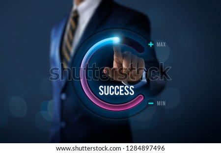 Success in business or personal success concept. Businessman is pulling up circle progress bar with the word SUCCESS on dark tone background. #1284897496