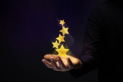 Success in Business or Personal Talent Concept. Gesture Hand with Golden Five Star Awards