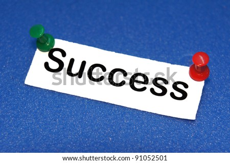 success note pinned on blue softboard background