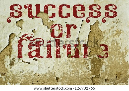 success or failure - text on old wall