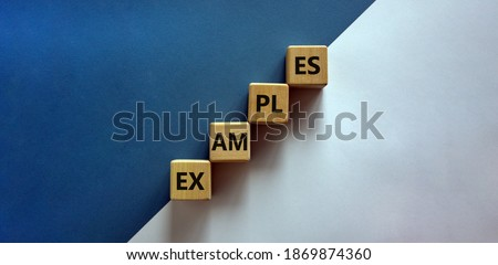 Success process and examples symbol. Wood blocks with word 'examples' stacking as step stair on paper blue and white background, copy space. Business and examples concept. ストックフォト ©