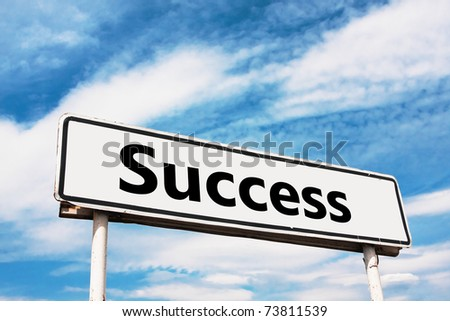 Success road sign against a background of blue sky with clouds