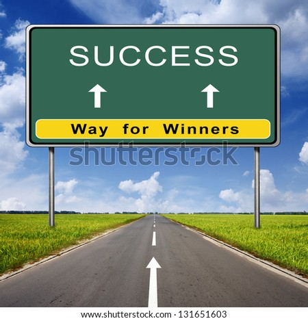 success road sign on blue sky background and green field