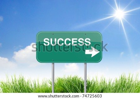 success  road sign on sky