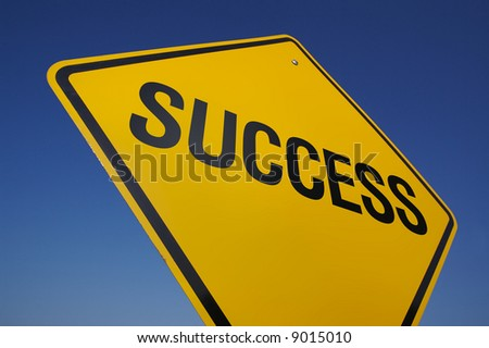Success Road Sign with Dramatic Blue Sky.