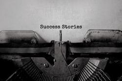 Success Stories typed words on a vintage typewriter