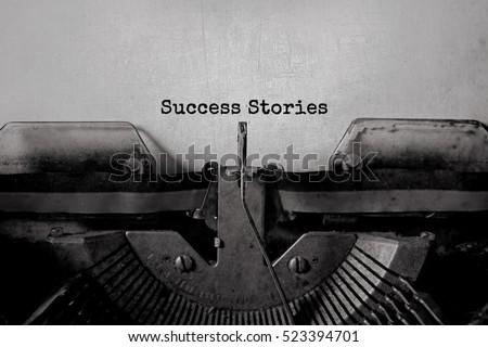 Success Stories typed words on a vintage typewriter #523394701