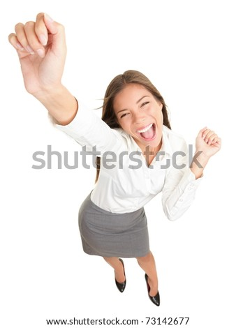 Success. Successful businesswoman cheering and dancing celebrating victory. Dynamic high angle view of young beautiful Asian Caucasian casual business woman. Isolated on white background in full body.