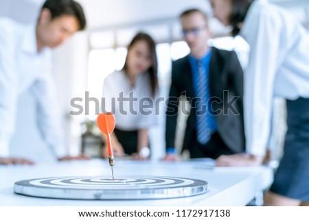 Success target symbol business concept with arrow on blur background of people are meeting marketing plan in office