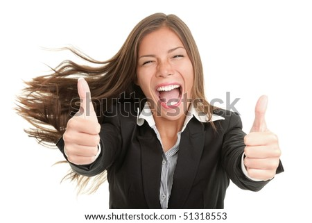 Success woman excited giving thumbs up. Young smiling mixed Chinese Asian / Caucasian businesswoman. Isolated on white background