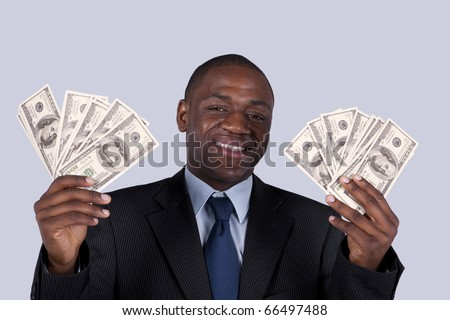 Successful and wealthy african businessman showing you money