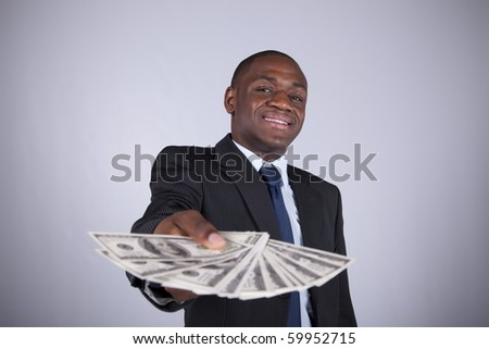 Successful and wealthy african businessman showing you money (isolated on white)