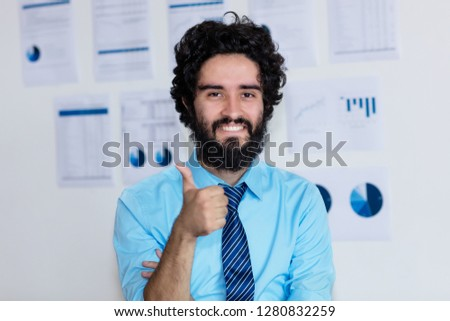 Successful arabic businessman with beard and tie at office of company