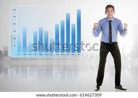 Successful asian businessman with growing graph in digital screen on beside his