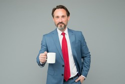 successful bank employee drink morning coffee. having business lunch. attorney with tea cup. businessman on lunch break. boss inspired with fresh beverage. mature boss need more energy