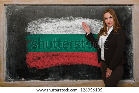 Successful, beautiful and confident woman showing flag of Bulgaria on blackboard for marketing research, presentation and tourist advertising