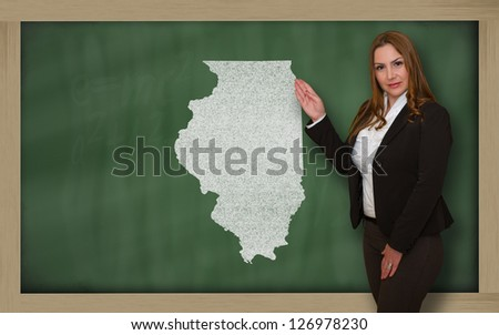 Successful, beautiful and confident young woman showing map of illinois on blackboard for presentation, marketing research and tourist advertising