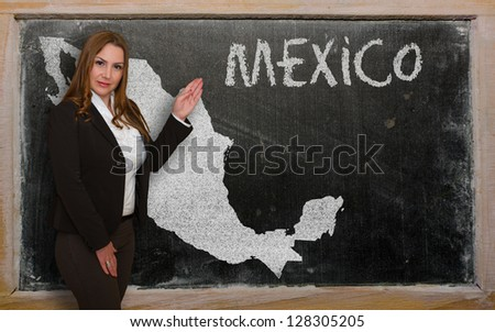 Successful, beautiful and confident young woman showing map of mexico on blackboard for presentation, marketing research and tourist advertising