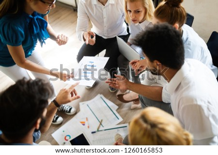 Successful business group of people at work in office #1260165853