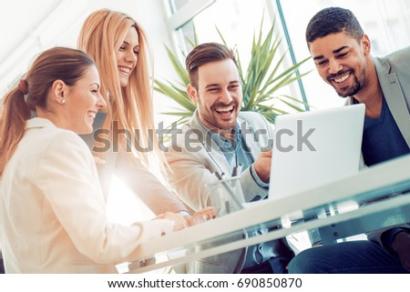 Successful business group working at the office #690850870