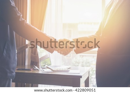 Successful business,Handshake,Business man holding hands closeup,selective focus,Vintage tone,copy spa