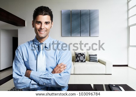 successful business man at his new modern house - stock photo