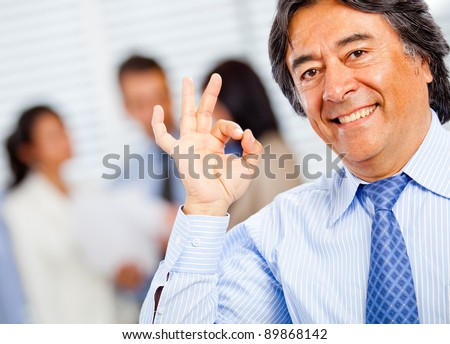 Successful business man making an ok sign with his hand