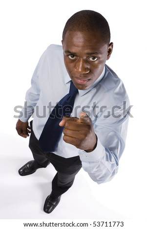 Successful business man pointing to someone with a serious expression