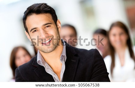 Successful business man smiling at the office