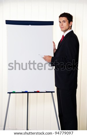 successful business man with a flip chart in a presentation