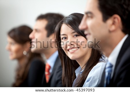 successful business people at the office smiling