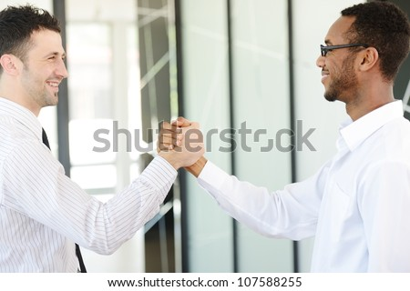 Successful business people hand shaking after great deal #107588255