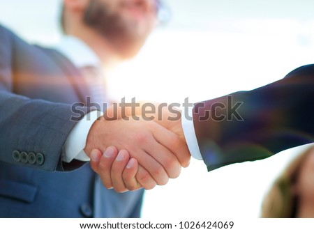 Successful business people handshaking after good deal. #1026424069