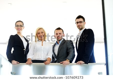 Successful business people standing on railing
