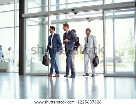 successful business people walking on the way in building