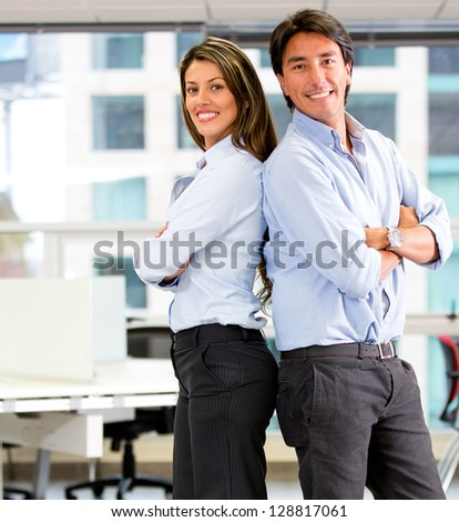 Successful business team at the office looking happy