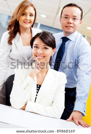 Successful business team at the office smiling