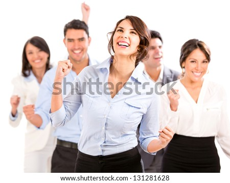 Successful business team celebrating with arms up - isolated over white - stock photo