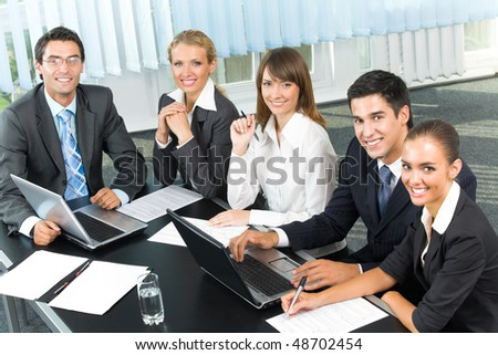 Successful business-team planning or brainstorming at office