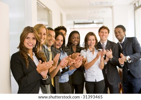 Successful business team smiling in an office