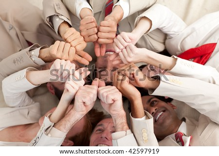 Successful business team with thumbs up lying on the floor in a circle